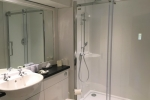 Bathroom with spacious walk in shower and rainfall showerhead